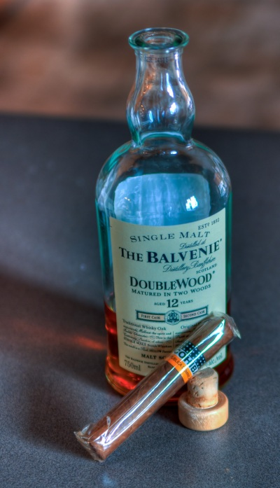 HDR image of a bottle of Balvenie Doublewood scotch and a Dominican Cohiba cigar