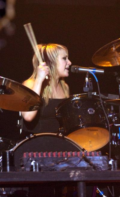 Jen Ledger of Skillet drumming and singing