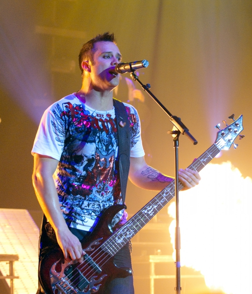 John Cooper of Skillet with fire